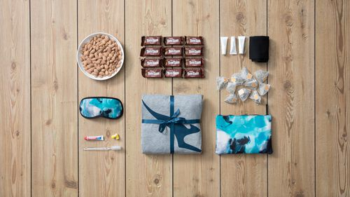 Items included in the pack are the iconic business class pyjamas, business class amenity kits featuring ASPAR skin products, as well as Tim Tams and snacks that would normally be offered to passengers travelling in premium cabins.