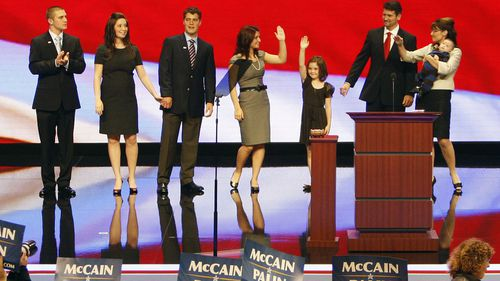 Sarah Palin, right, is pictured with her family on stage during the 2008 US election campaign where she was the Republican vice presidential nominee. Her son Track is on the far left. (Photo: AP)
