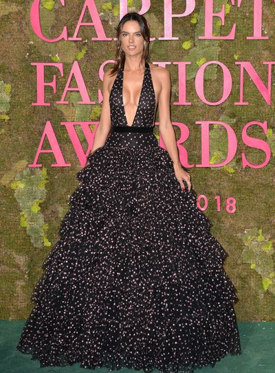 Model Alessandra Ambrosio wears Philosophy di Lorenzo Serafini. The black tulle fabric is made from regenerated polyester, embellished with all over sparkling purple embroideries using recycled polyester thread.