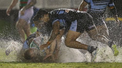 Cronulla Sharks upset the Rabbitohs in torrential conditions