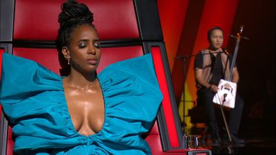 Kelly Rowland listens to a Mongolian folk singer during the Blind Auditions of The Voice 2020