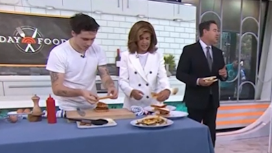Brooklyn Beckham makes a bacon, sausage and egg sandwich during a cooking segment on the US Today Show