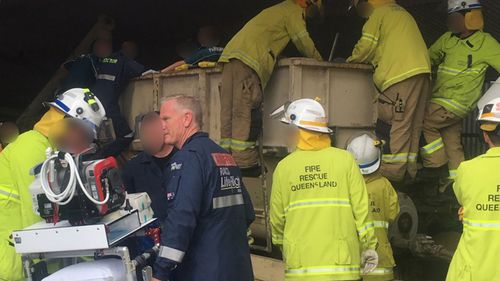 Emergency services working to free Gavin Boekel following an accident at a Queensland farm.