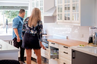 AFTER: Fotis and Jess checking out the functionality of their new kitchen