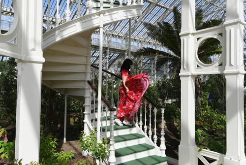 A woman looks at plants in the newly restored Victorian Temperate House. (AAP)
