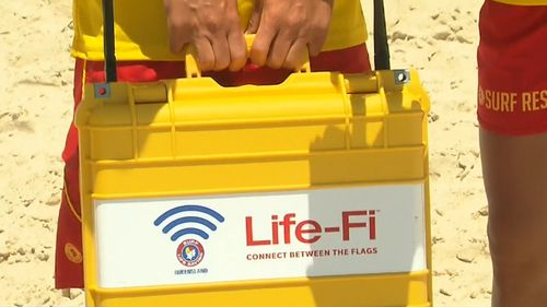 In a world-first trial wi-fi will be used to push safety alerts in seven languages to beach-goers in Queensland.