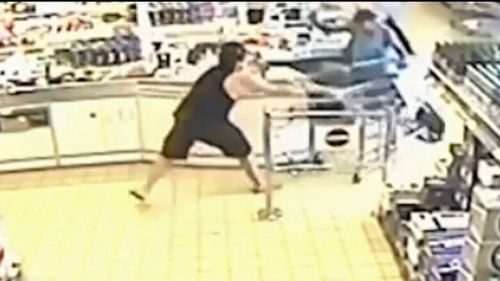 The baseball bat-armed Davidson was stopped by employees and customers.
