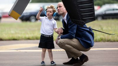 The father and son examined a helicopter at the show.
