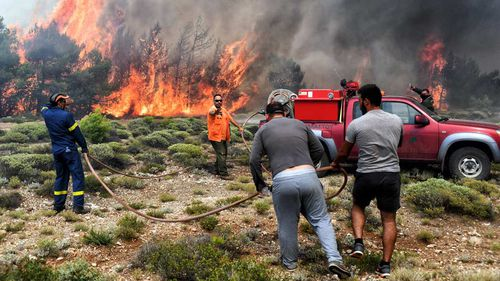 The speed with which the blaze northeast of Athens spread took many by surprise, and is believed to have contributed to the high death toll. Picture: EPA