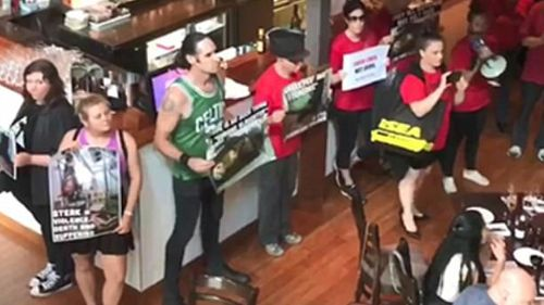 Protesters stormed the Rare Steakhouse in Melbourne's CBD. (Facebook)