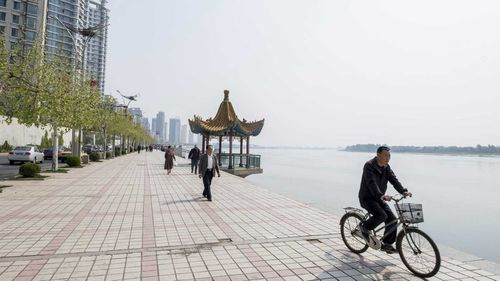 High rise apartment developments contrast sharply with the rural emptiness of North Korea across the Yalu River at Dandong.