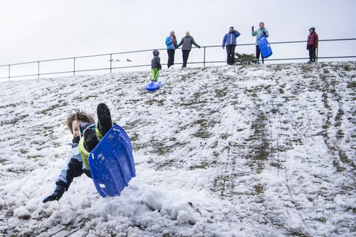Kids making the most of the cold weather at Blackheath. Photo: Wolter Peeters / SMH