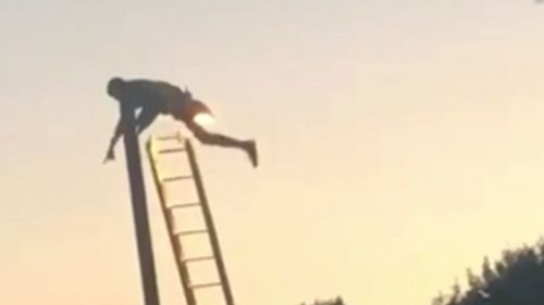 The man became stuck at the top of a lamp post in the UK. Picture: Supplied
