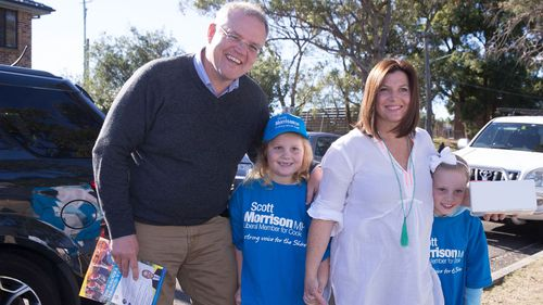 Mr Morrison with his wife Jenny with their children Lily (middle) and Abby (far right) at the 2016 election.
