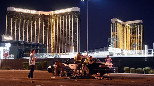 Police on guard outside Mandalay Bay resort from which Paddock opened fire before shooting himself. (Getty)