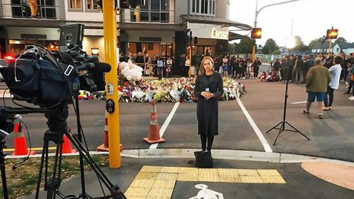 Sophie Walsh preparing for a live cross in the wake of the mass shooting.