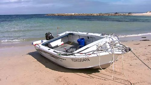Two men and a woman were pulled from waters at Boat Harbour in Kurnell after the vessel flipped over. Picture: 9NEWS.