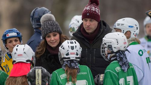 The royal couple talk to bandy players. (PA)