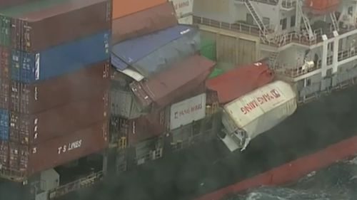 The 83 containers are believed to have fallen from the ship in the middle of the night and been opened by the impact. Picture: 9NEWS.