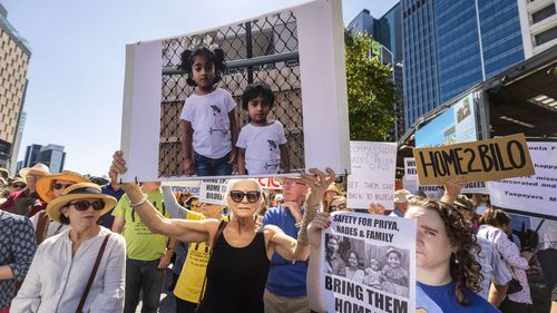 Supporters of Tamil asylum seekers Nadesalingam, Priya and their Australian-born children Kopika and Tharunicaa are seen at a rally outside Brisbane City Hall, Brisbane.