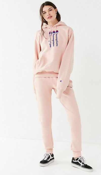 "<p><a href=""https://www.urbanoutfitters.com/shop/champion--uo-reverse-weave-jogger-pant?category=SHOPBYBRAND&color=066"" target=""_blank"" draggable=""false"">Champion & UO Reverse Weave Jogger Pant</a>, $82.67, and <a href=""https://www.urbanoutfitters.com/shop/champion-uo-novelty-graphic-hoodie-sweatshirt?color=066"" target=""_blank"">Hoodie Sweatshirt</a><br> $87.75</p>"