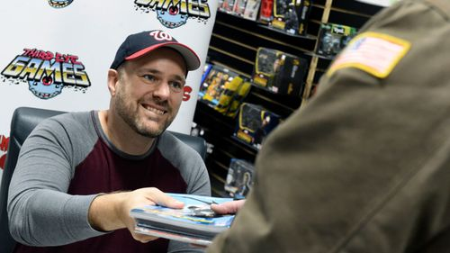 Batman comic author Tom King hands out free comics to US government workers affected by the shutdown in a special signing event in Baltimore.