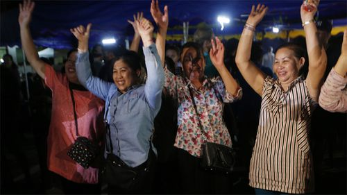 Locals cheer upon news the boys have been freed. Picture: AP