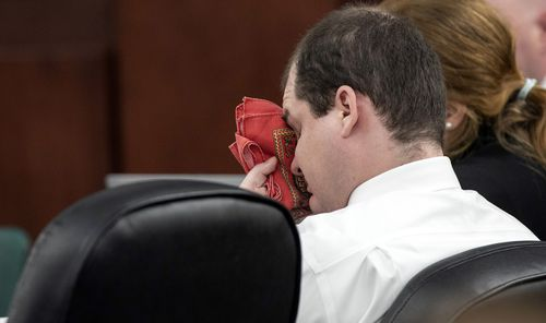 Tim Jones wipes his eyes as his ex-wife, Amber Kyzer, testifies during the sentencing phase of his trial in Lexington.  Photo: Tracy Glantz/The State/Pool via USA TODAY NETWORK/Sipa USA.