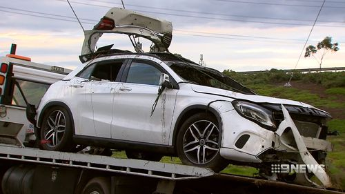 The car was a luxury Mercedes. One of the victims was a mechanic for the car company.