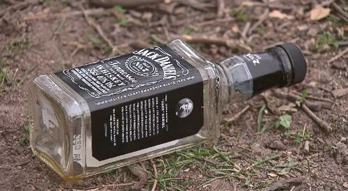 Alcohol bottles were found on the ground at the park.