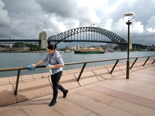 Railings being cleaned at the Sydney Opera House forecourt during the coronavirus crisis.