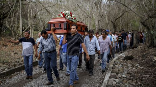 Members of the Solecito search group carry the coffin of Pedro Huesca, a police detective who disappeared in 2013 and was found in a mass grave in 2017, to the cemetery in Palmas de Abajo, Veracruz, Mexico. Huesca's remains are among more than 250 skulls found over the last several months in what appears to be a drug cartel mass burial ground on the outskirts of the city.