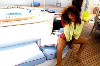 Rihanna shares pics of her vacation sailing around the coast of Italy.