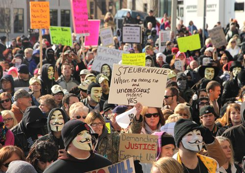 People protest at the Jefferson County Courthouse in Steubenville, Ohio, in January 2013. Some are wearing masks associated with hoacking collective Anonymous, who leaked a damning video, images, emails and other information about the crime.