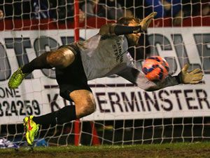 Sam Slocombe of Scunthorpe United saves a penalty. (Getty)