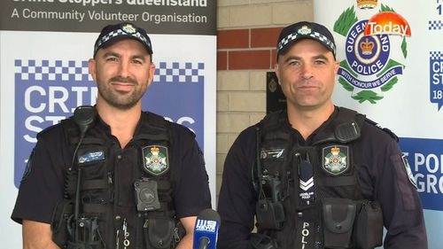 Const Jeremy Gardiol (left) and Sen-Const Kevin Mayo were called to a traffic accident and found the driver trapped. Picture: 9NEWS