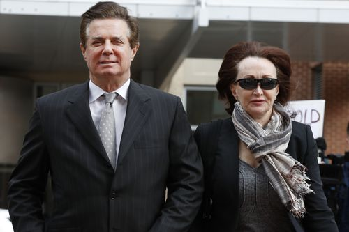 Paul Manafort, President Donald Trump's former campaign chairman, walks with this wife Kathleen Manafort, as they arrive at the Alexandria Federal Courthouse. Picture: AP