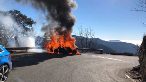 Harris was behind the wheel of a new $90,000 Alpine sports car when it burst into flames. (AAP)