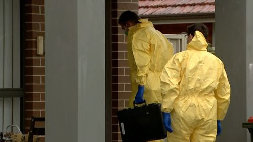 Forensic police at the crime scene in Quakers Hill.