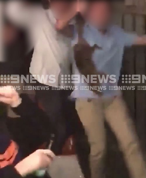Partygoers can be seen drinking, dancing and laughing as the possum is being tortured. (Supplied)