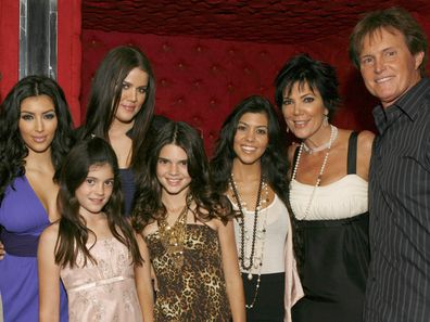 "Ryan Seacrest, Kim Kardashian, Kylie Jenner, Khloe Kardashian, Kendall Jenner, Kourtney Kardashian, Kris Jenner and Bruce Jenner pose for a photo at the ""Keeping Up With the Kardashians"" viewing party at Chapter 8 Restaurant on October 16, 2007 in Agoura Hills, California. (Photo by Jeff Vespa/WireImage)"