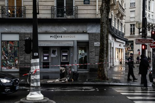 A group of armed robbers conducted a daring heist at a high-end bank on the Champs Elysees in Paris yesterday.