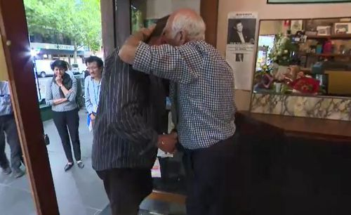 Mr Pangrazio greeted customers with hugs as they entered the shop at 8am and was offering free long blacks.
