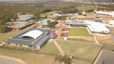 Boys charged over vandalism attack that shut down school