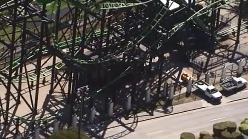 Workers at Movie World's Green Lantern ride today. (9NEWS)