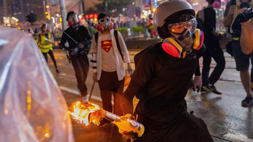 A Molotov cocktail is hurled during Hong Kong's protests.