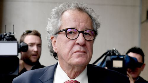 Geoffrey Rush arrives to court for the judgement.