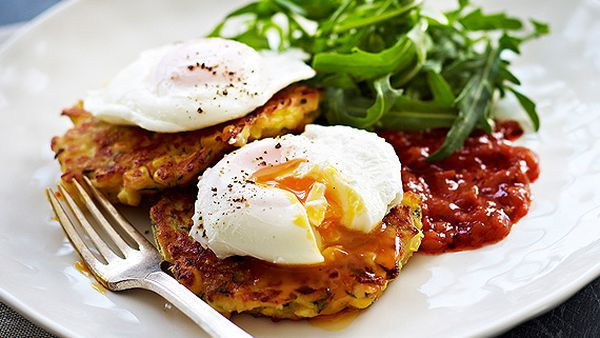 Cheesy corn and zucchini fritters, poached eggs and tomato relish