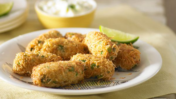 Coconut fish fingers with pineapple raita