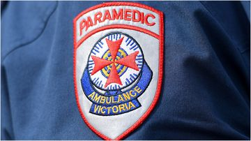 A woman has died after reversing her car from a crash scene in Melbourne.